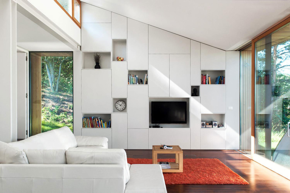 Place Small Table and White Sectional Sofa in Cozy Family Room with Stunning White Floating Shelves