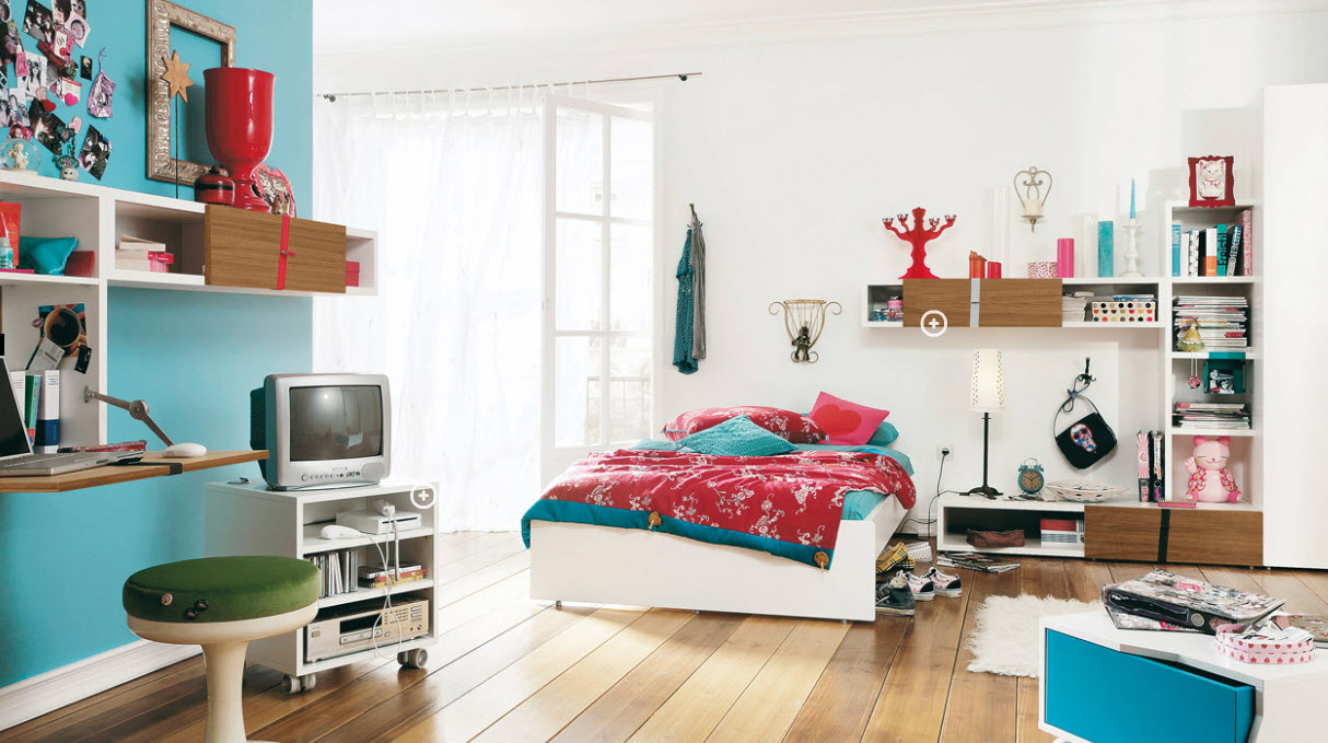 Place White Bed and Colorful Bedding beside Bookshelves in Wide Teenage Girl Room Ideas