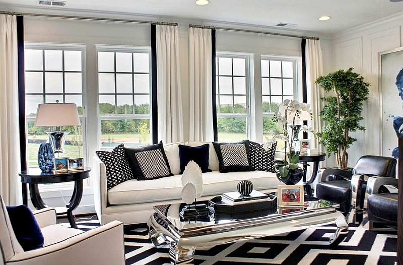 Reflective Coffee Table Placed In Gorgeous Sitting Room With White Sofas On  Black And White Rug