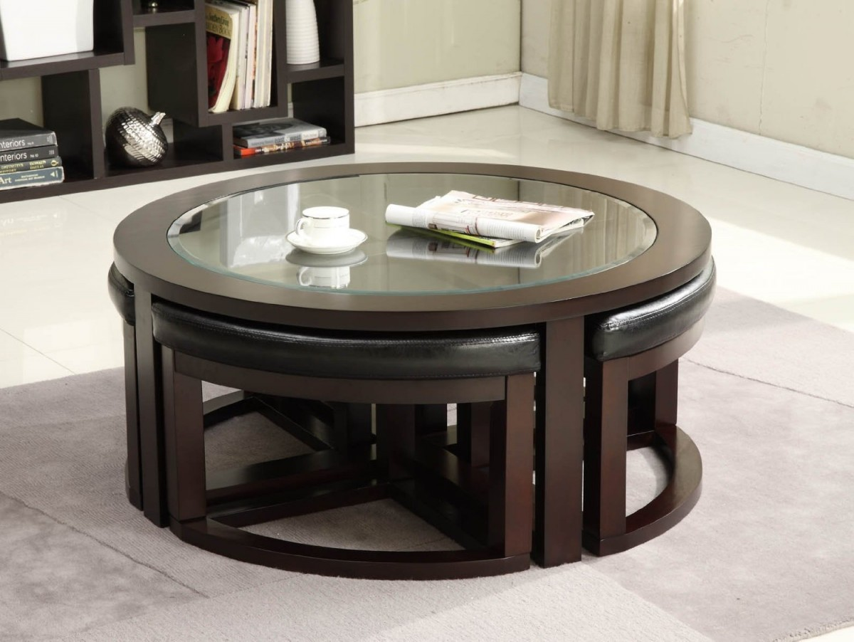 Round Glass Coffee Table with Small Stools for Minimalist Living Room using Dark Bookshelves on Marble Tile Flooring