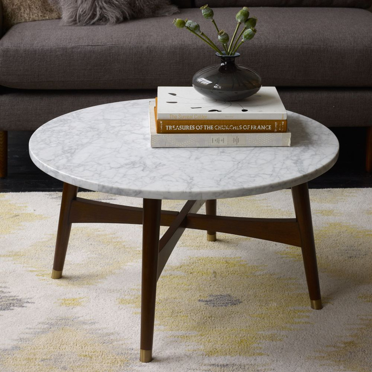 Superbe Round Marble Top And Wooden Legs For Small Coffee Table Placed Near Grey  Sofa