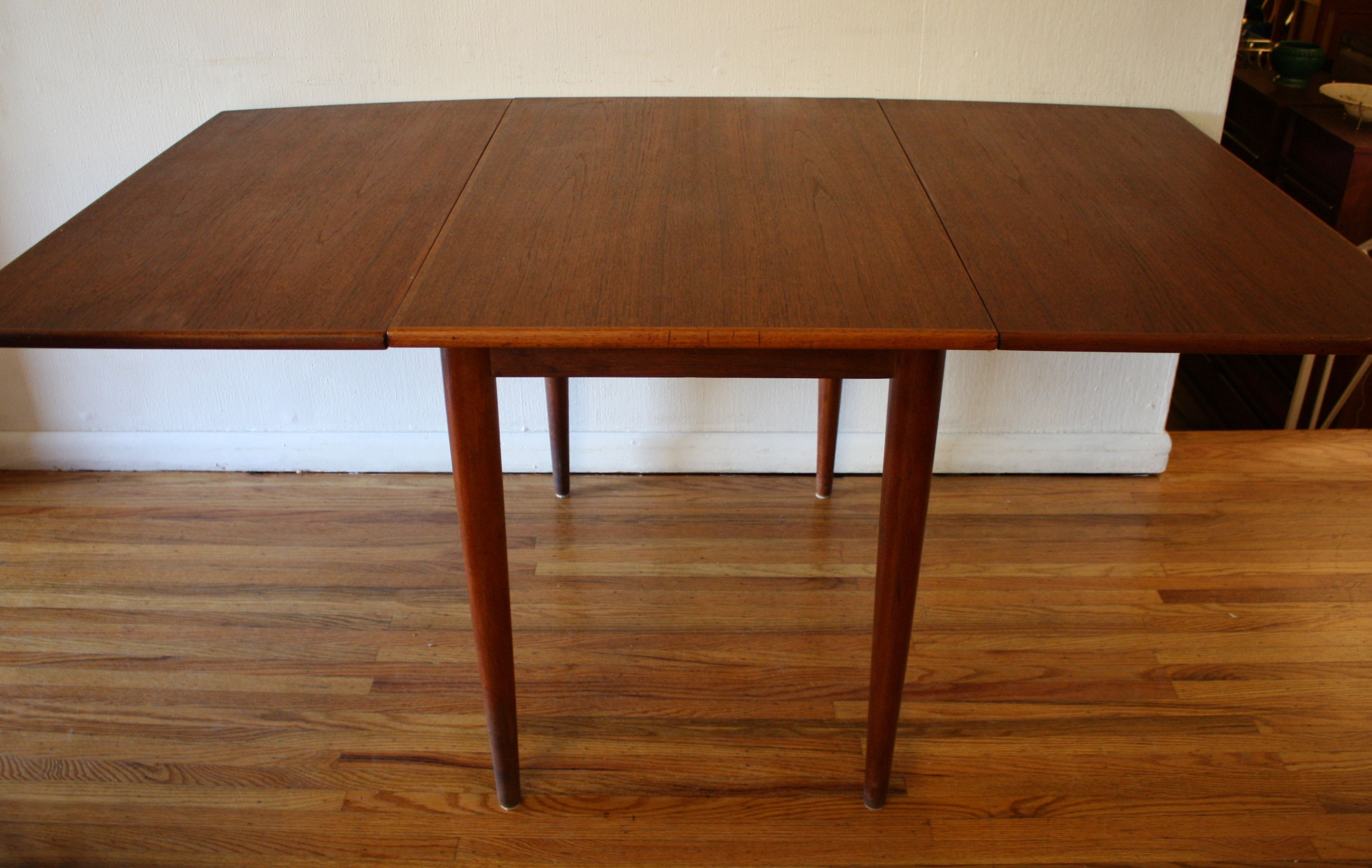 Simple Folding Dining Table Design with Wood Material and Small Legs on Hardwood Flooring