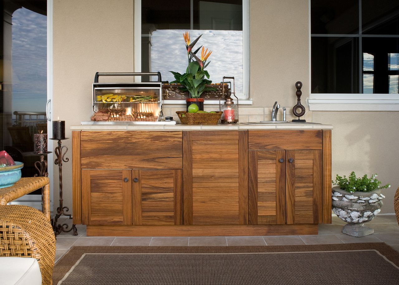 Simple Outdoor Kitchen Cabinets with Wooden Cabinets and Granite Top near Wicker Table and Chair