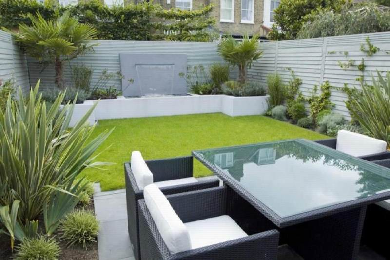 Small Backyard Ideas with Green Grass Yard and Wicker Sofas near Glass Top Table