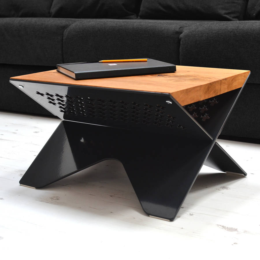 Small Coffee Table With Wooden Top And Glossy Dark Metal Legs Near Long  Black Sofa