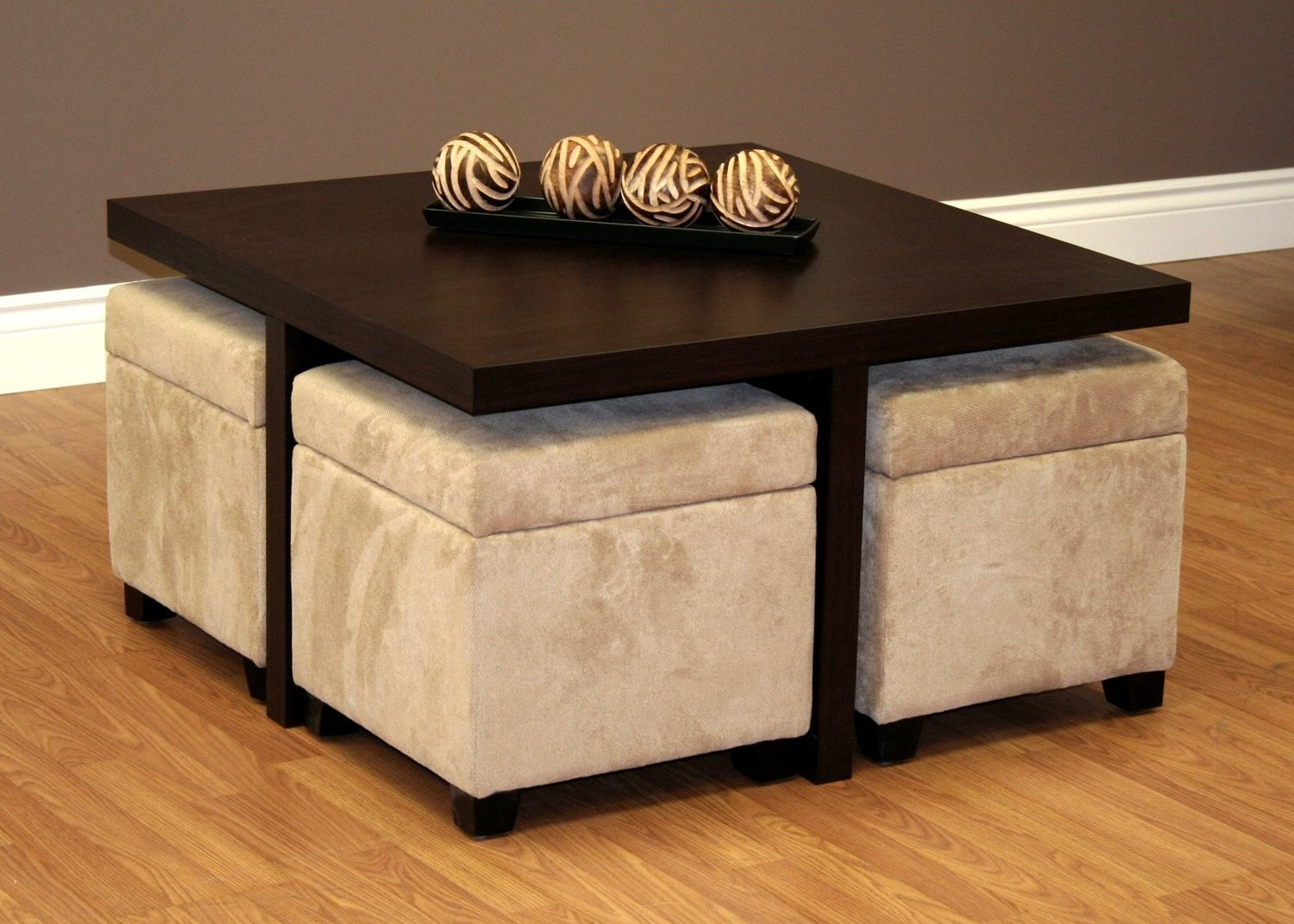 Square Ottomans Completing Dark Wooden Coffee Table with Stools on Laminate Hardwood Flooring near Grey Wall