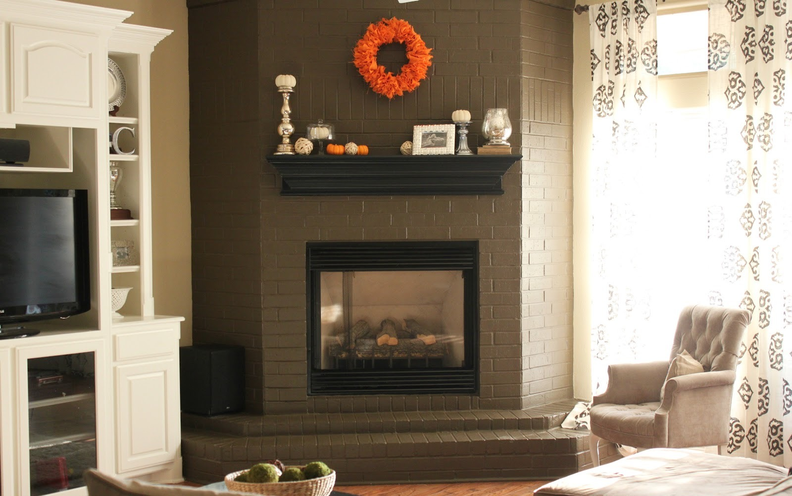 stunning living room with black fireplace and classic fireplace mantel decor on grey brick wall - Black Fireplace Mantels