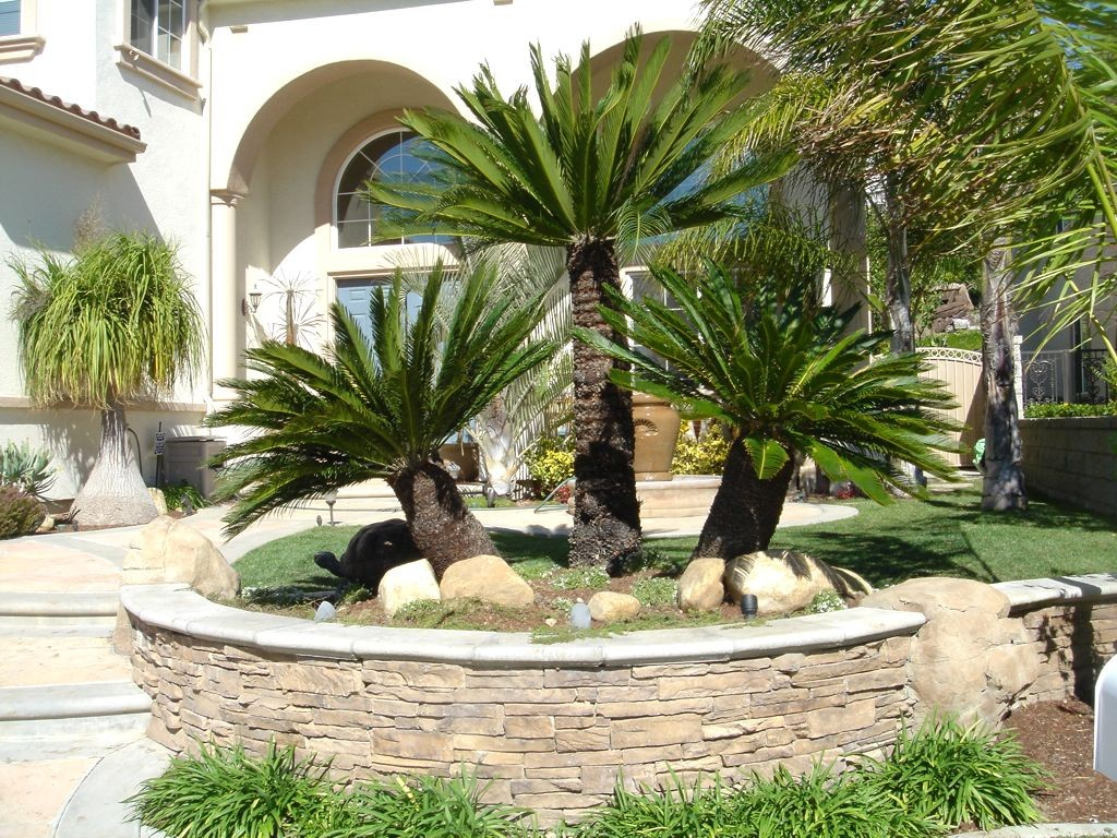 Summer Themed Front Yard Ideas with Stone Details and Green Grass Area near Old Fashioned Porch