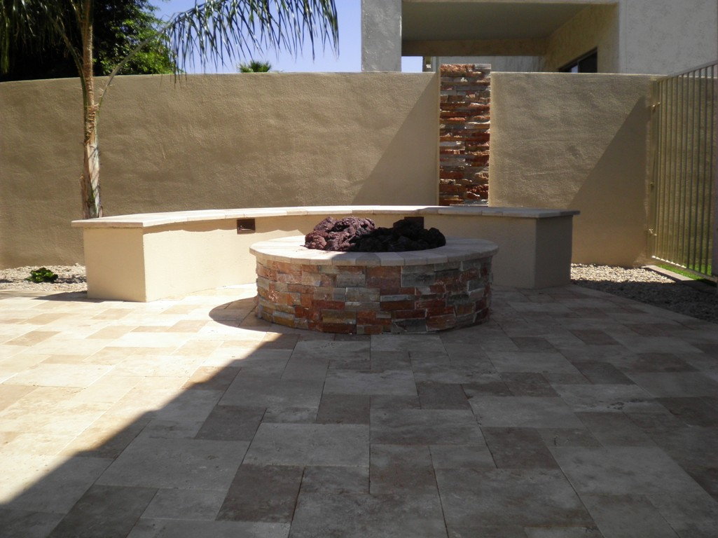 Sumptuous Round Fireplace front Seat Space in Backyard with Palm Tree