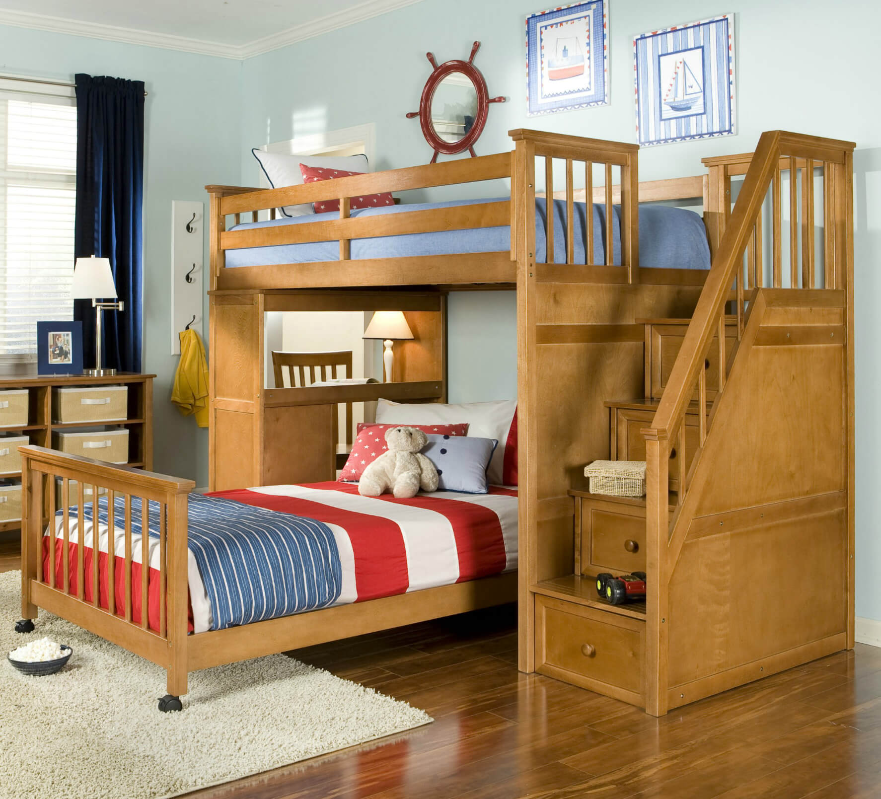 The Awesome Kids Bedroom with Wide Wooden Bunk Beds and Tidy Oak Shelves near Light Blue Wall