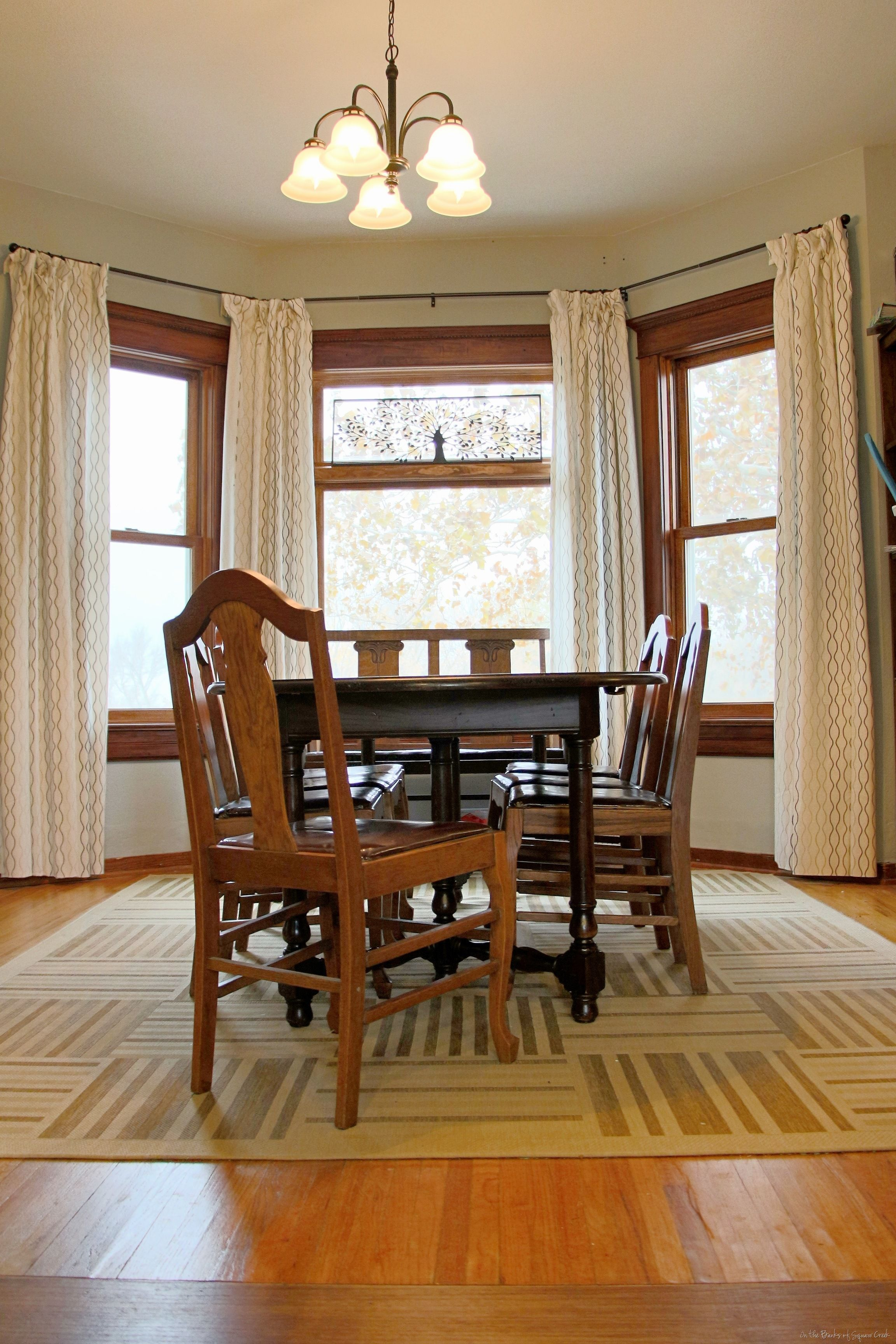 The Traditional Room with Dark Oak Table and Teak Chairs on Cream Dining Room Rugs