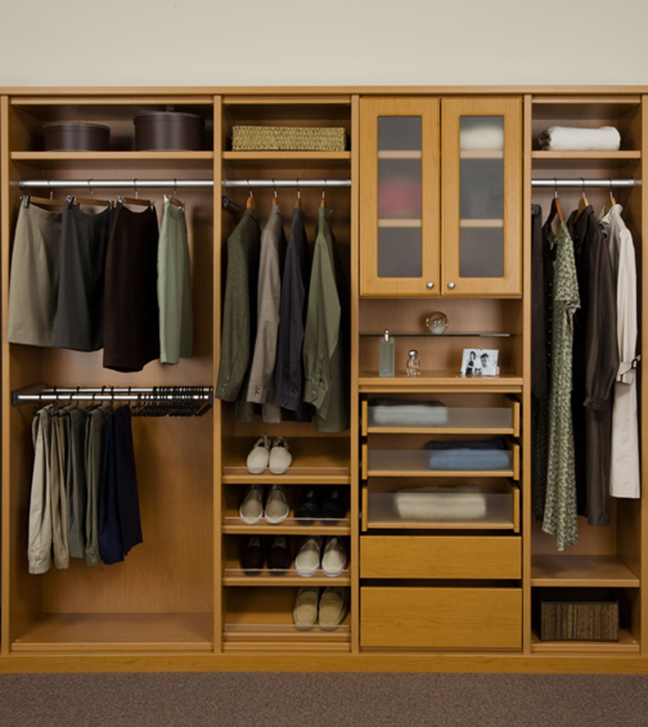 Tidy Closet Organizer Ideas with Wooden Shelves and Cabinets near Metal Clothes Hangers