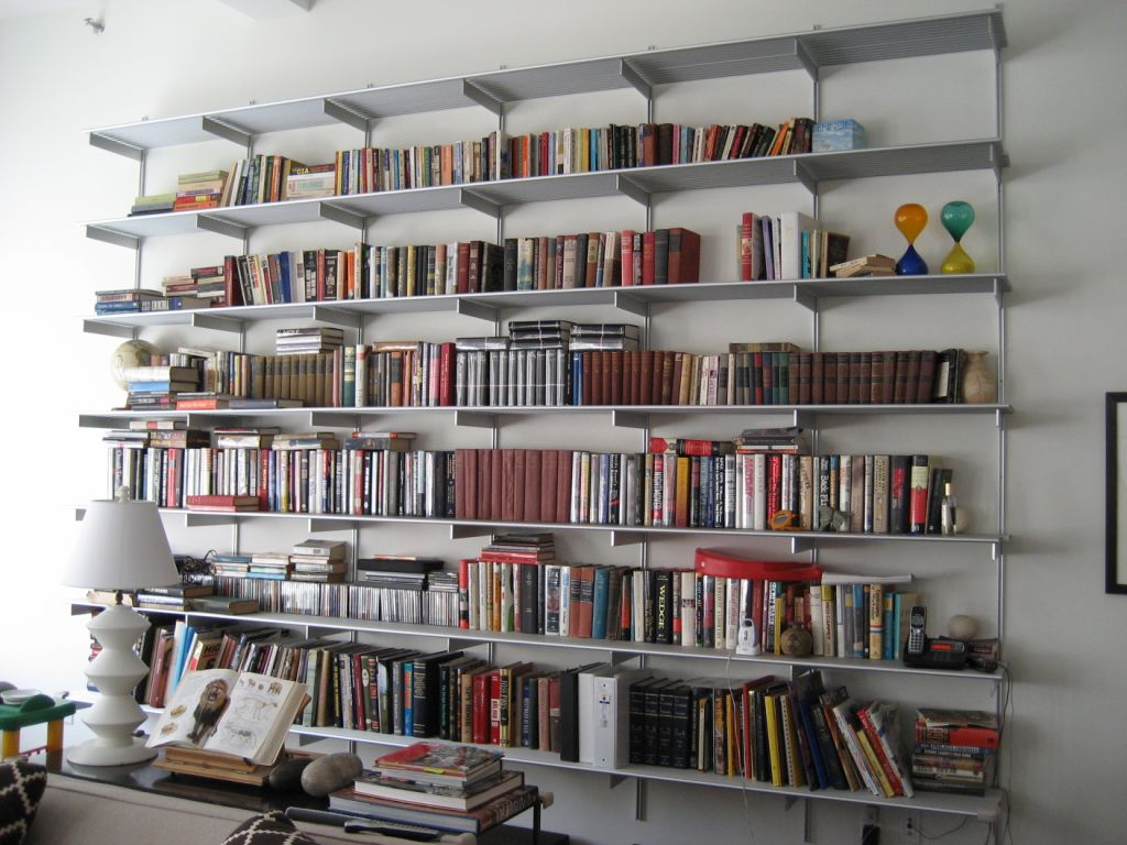 Genial Tidy Wall Mounted Bookshelves With Colorful Books Inside Appealing Living  Room Using White Wall