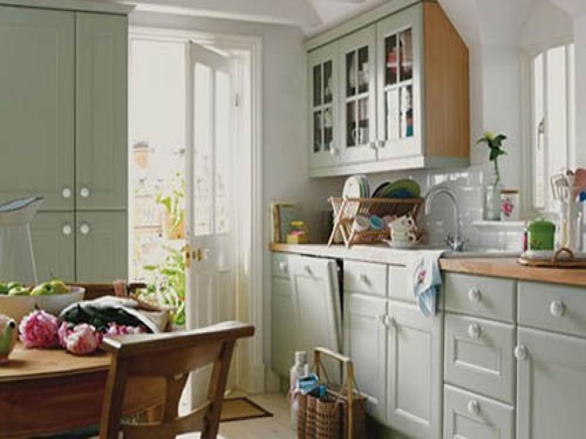Traditional Grey Counter and Cabinets facing Round Oak Table and Chairs for Country Kitchen Ideas