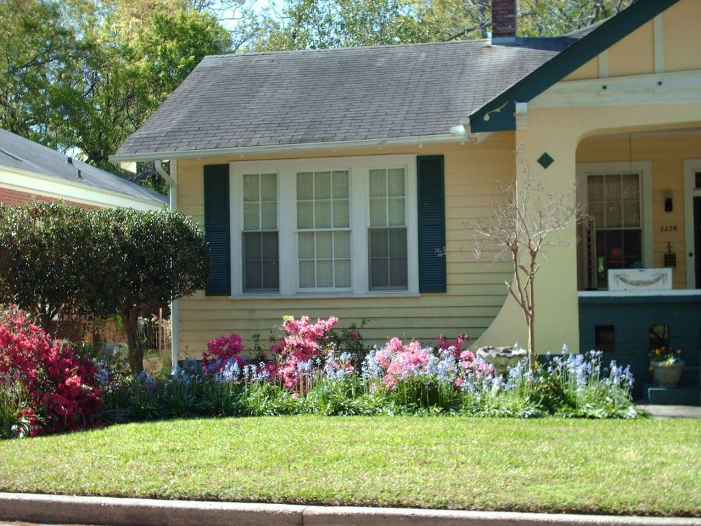 Traditional House Completed with Interesting Flower Garden Ideas using Pink and Blue Flowers near Grass Area
