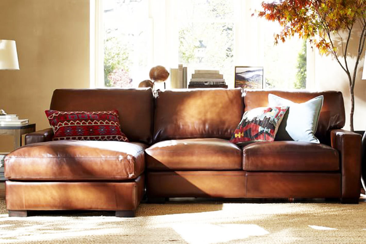 Traditional Leather Pottery Barn Sofa and Fluffy Cushions Placed inside Awesome Living Room
