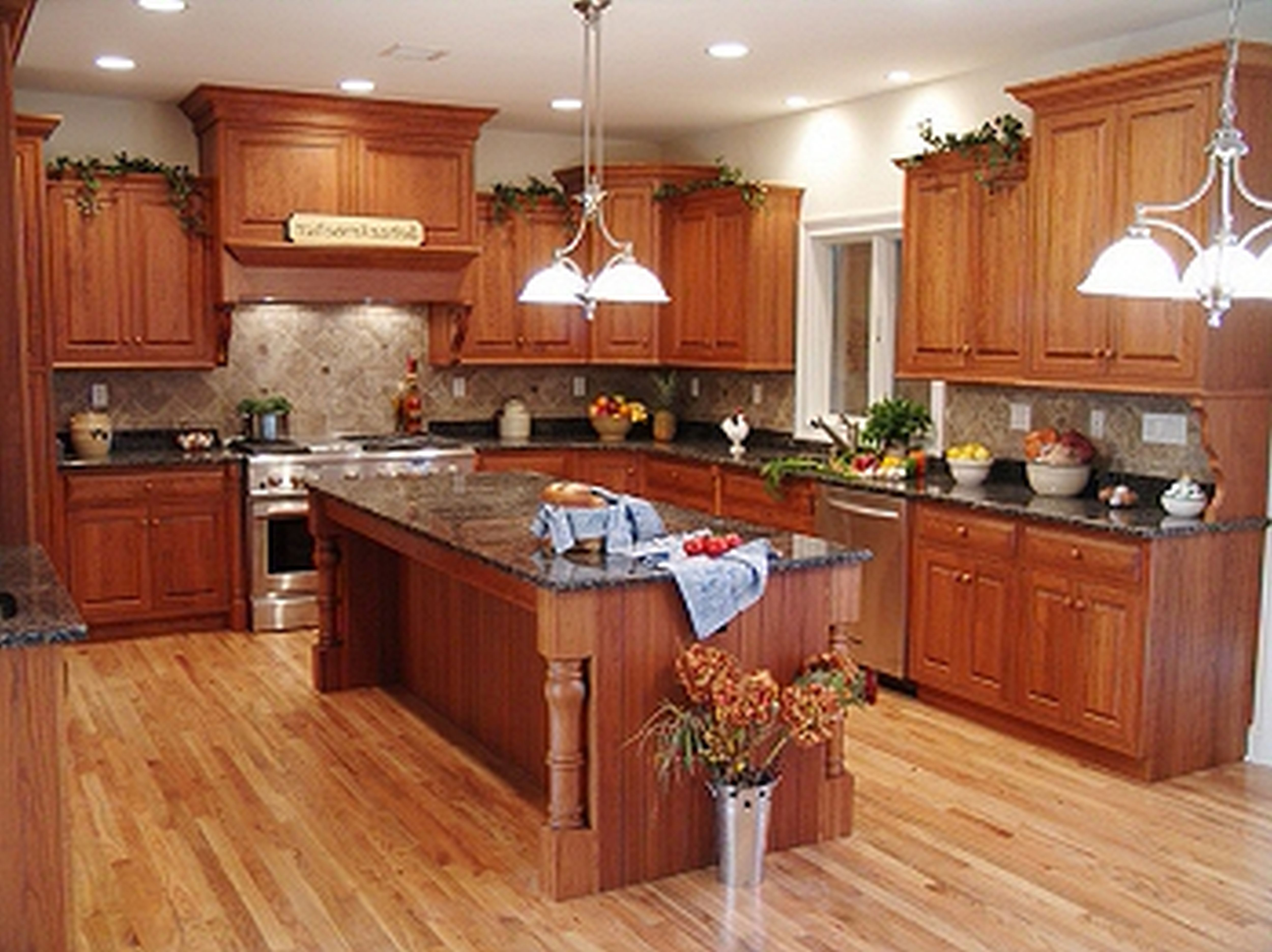 Traditional Wooden Kitchen Island Plans Placed in the Center of Traditional Kitchen with Long Oak Counter