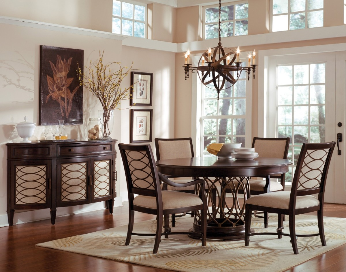 Unique Chandelier Completing Formal Dining Room With Round Dining Table  Centerpieces And Comfy Chairss
