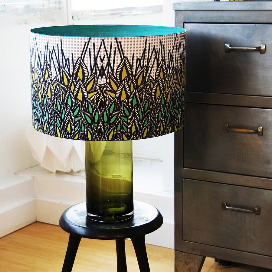 Unique Handle and Artistic Drum Lamp Shades for Appealing Table Lamp on Black Round Table