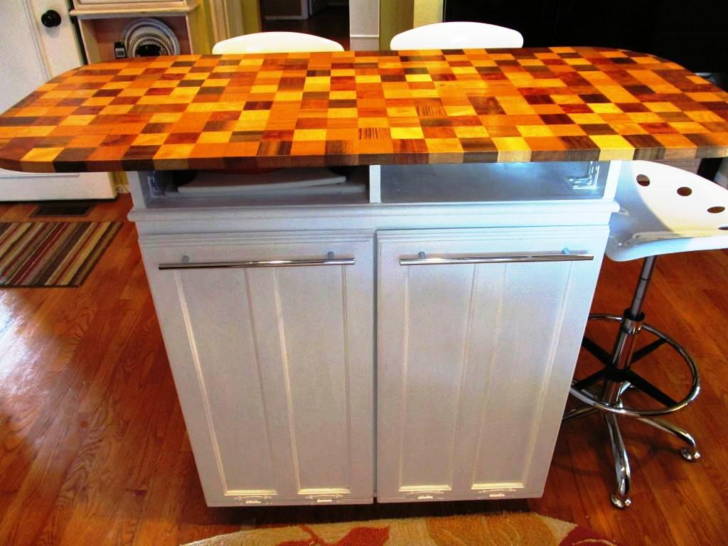 Unusual Top for White Rolling Kitchen Island with Lower Shelves and Cabinets near White Stools