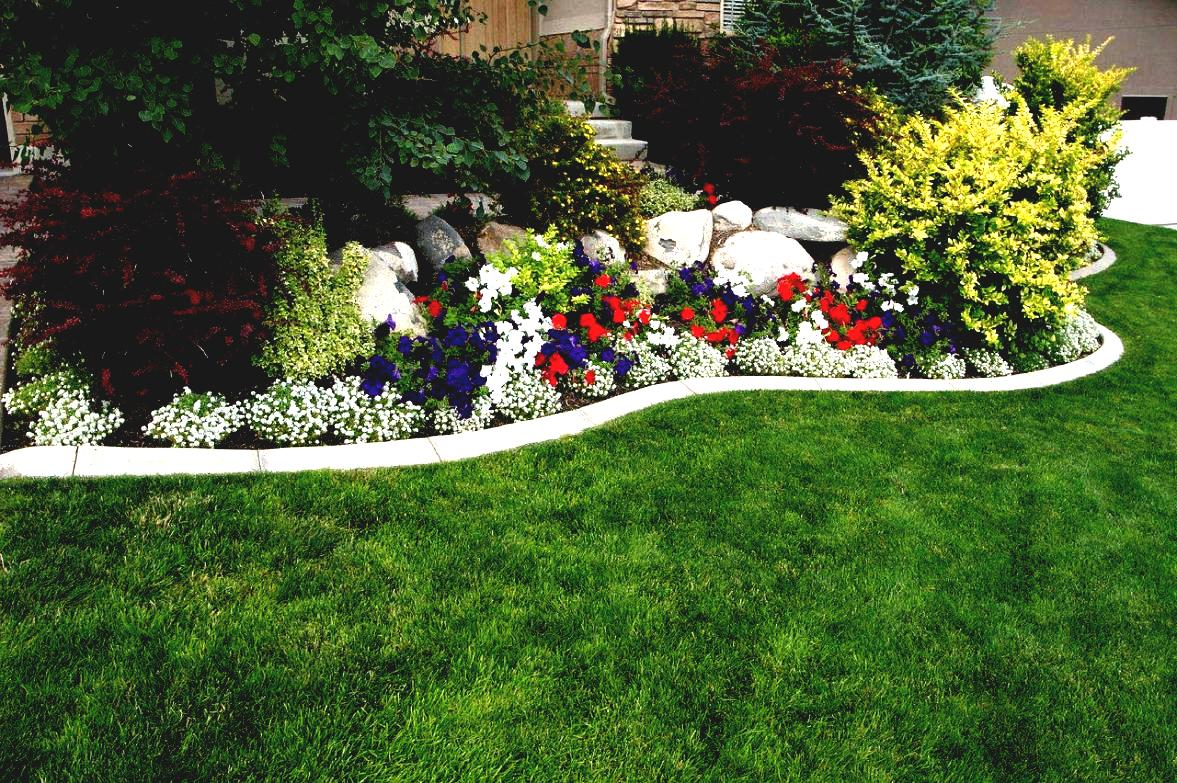 Use Blue and Red Flowers for Enchanting Flower Garden Ideas with Lush Plants near Green Grass Area