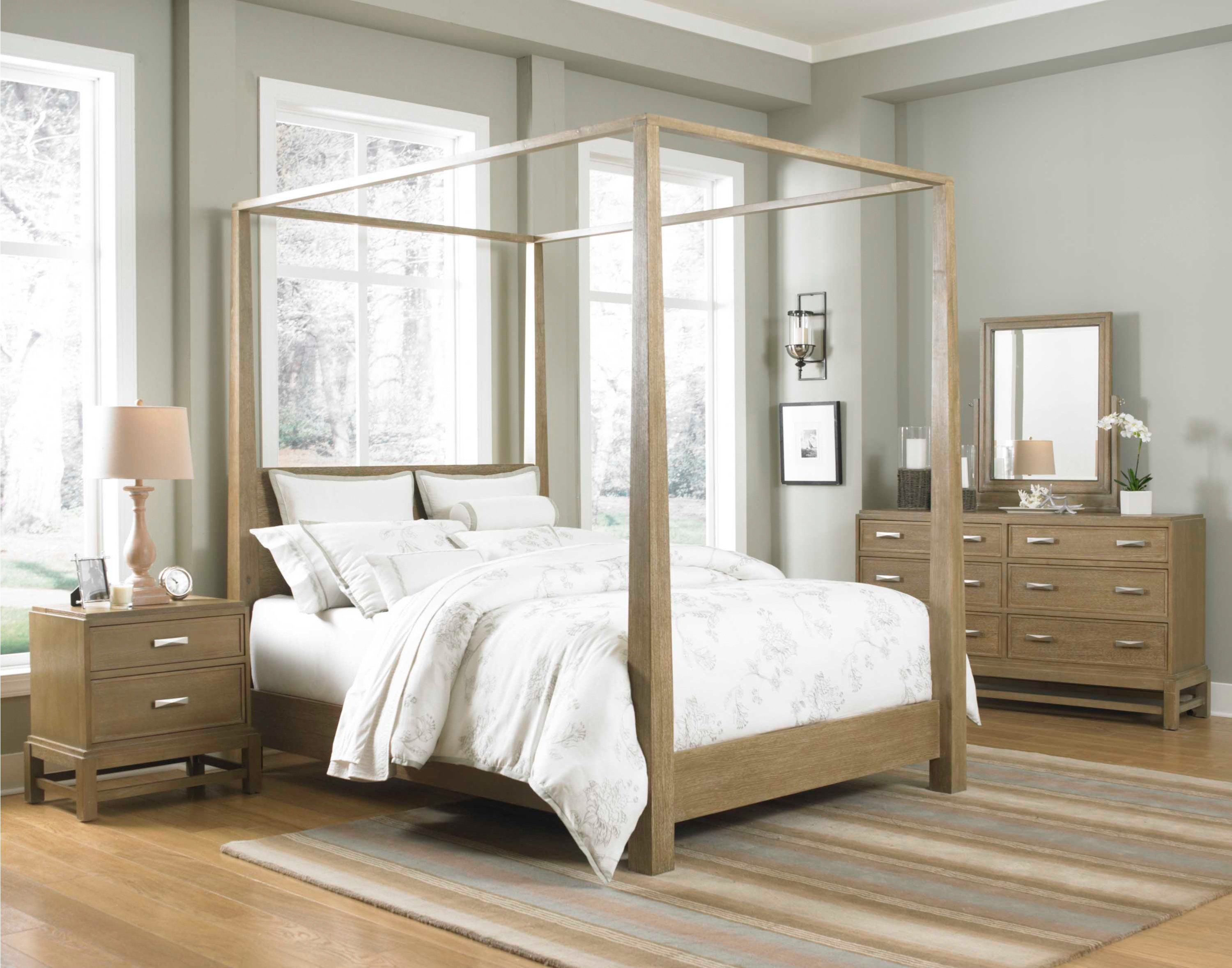 Use Canopy Bedroom Sets and White Bedding to Complete Cozy Bedroom with Oak Dressers on Wooden Flooring