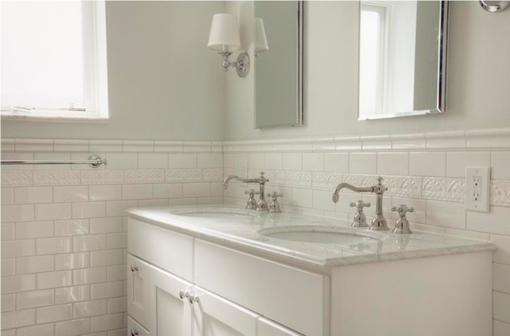 Use Classic Subway Tile Bathroom Wall to Decorate Small Area with White Vanity and Elegant Sink Faucets