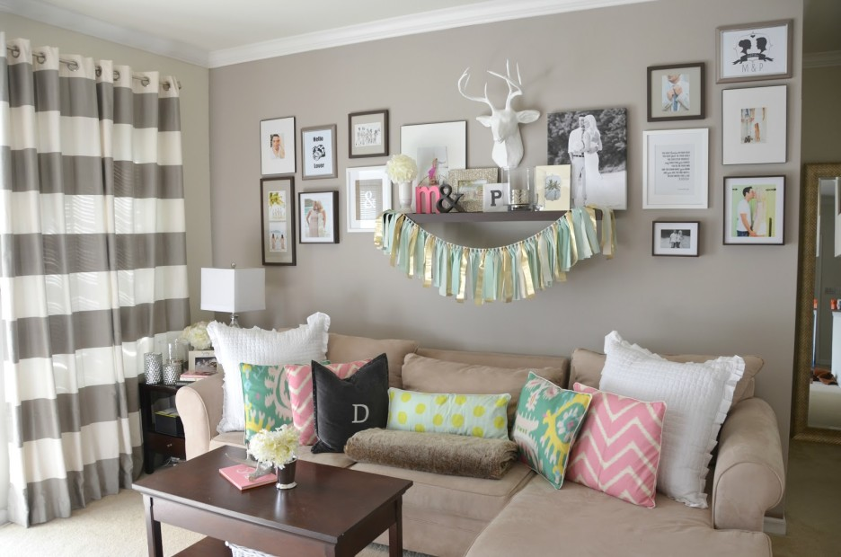 Use Colorful Square Cushions on Grey Sofa Chaise facing Wooden Table under Simple Floating Wall Shelves
