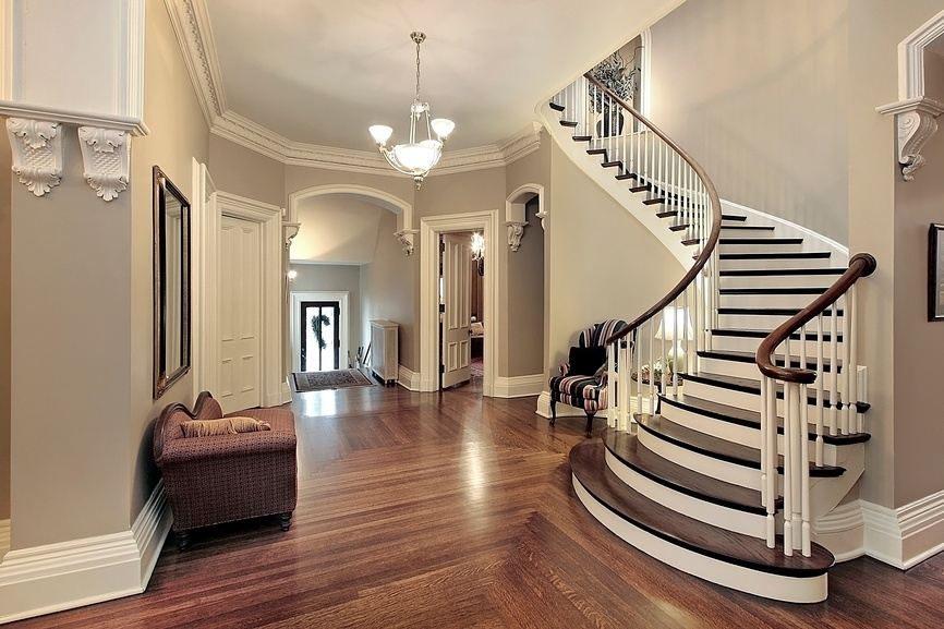 Charmant Use Crown Molding Ideas In Gorgeous Hallway With Swivel Staircase And  Fluffy Sofas Under Bright Ceiling