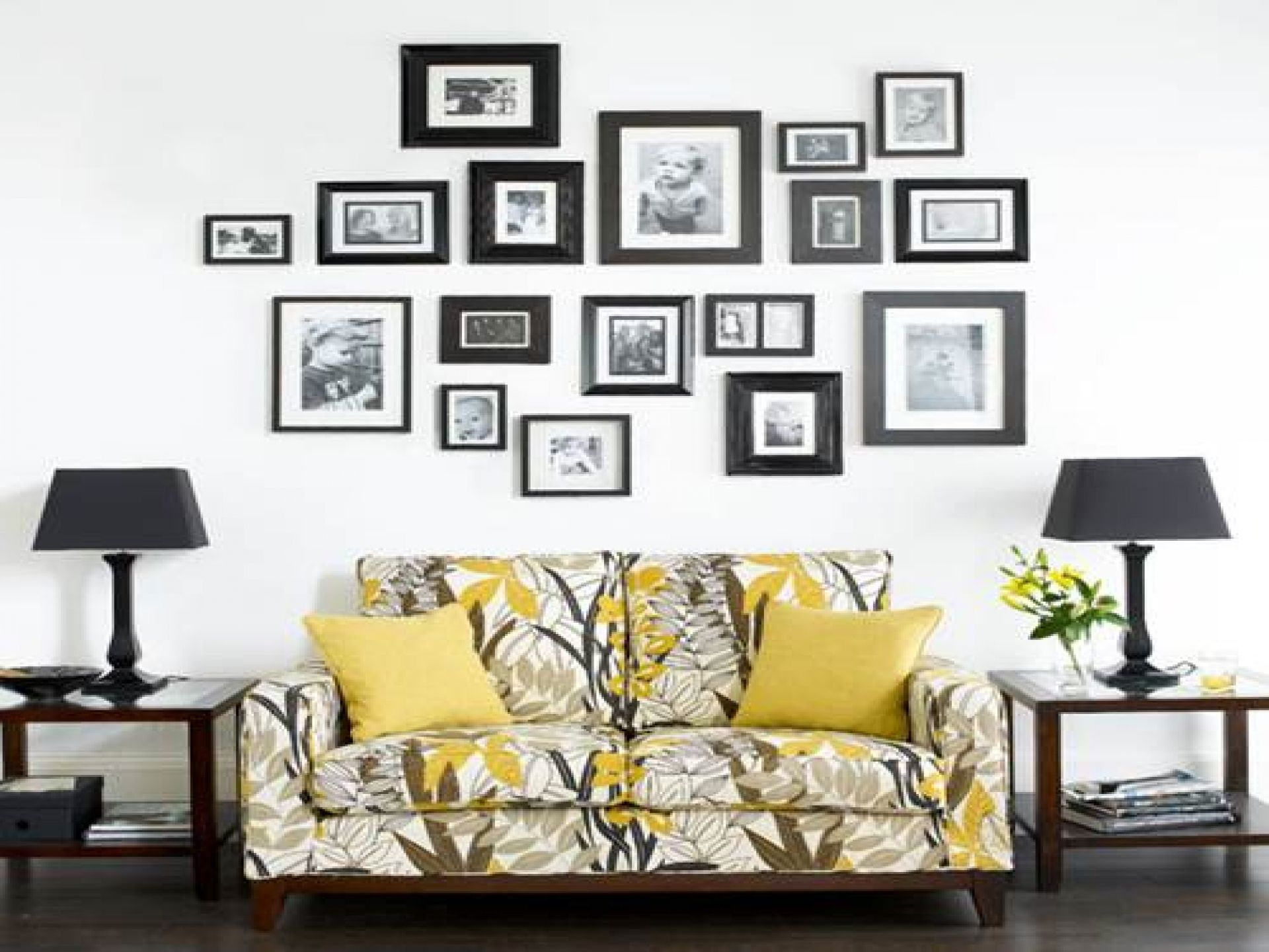 Use Family Photos as Wall Art Ideas for Family Room with Wooden Side Tables and Fluffy Sofa