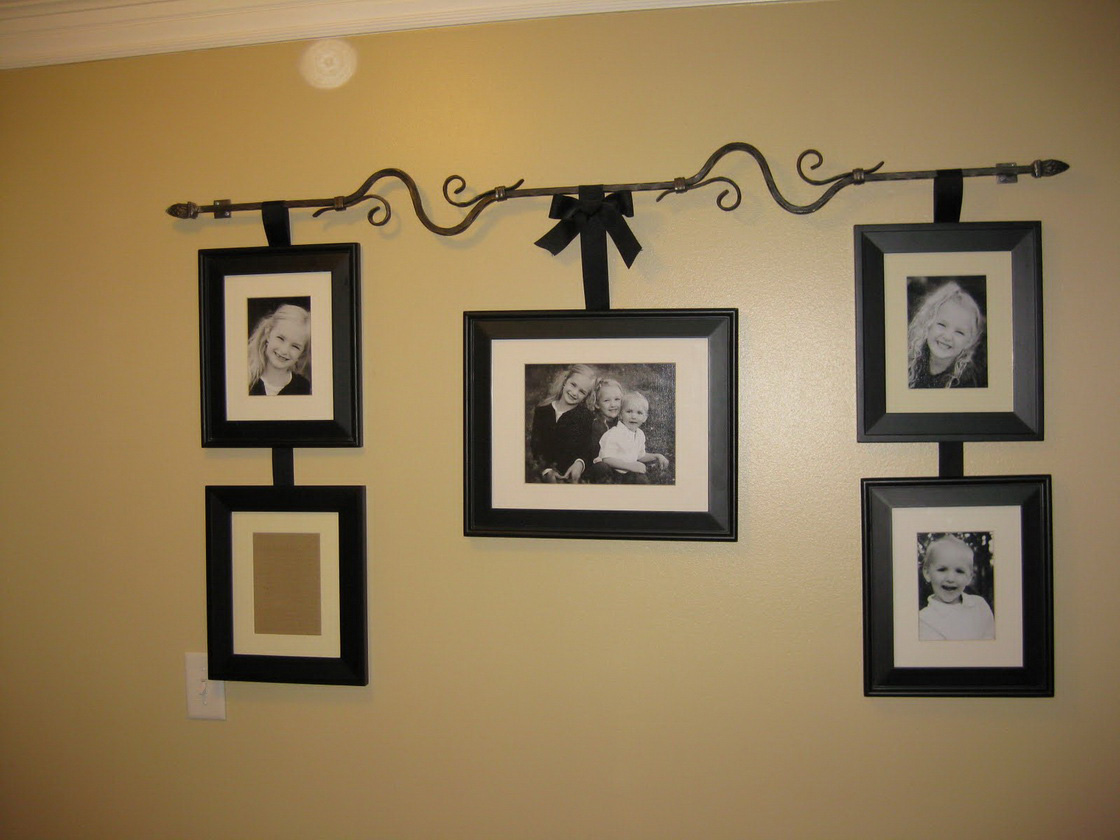 Use Framed Family Photos as Enchanting Wall Decoration Ideas on Cream Painted Wall under White Ceiling