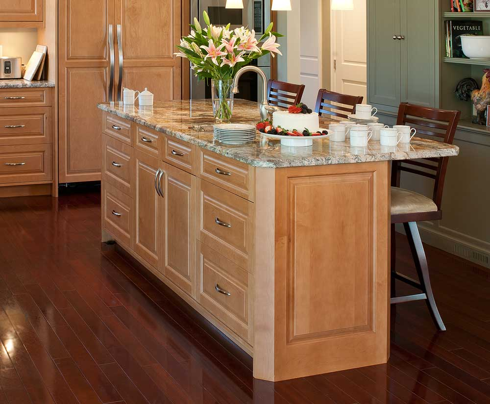 Use Marble Top for Oak Kitchen Island Plans Decorated with Beautiful Flowers and Wooden Stools