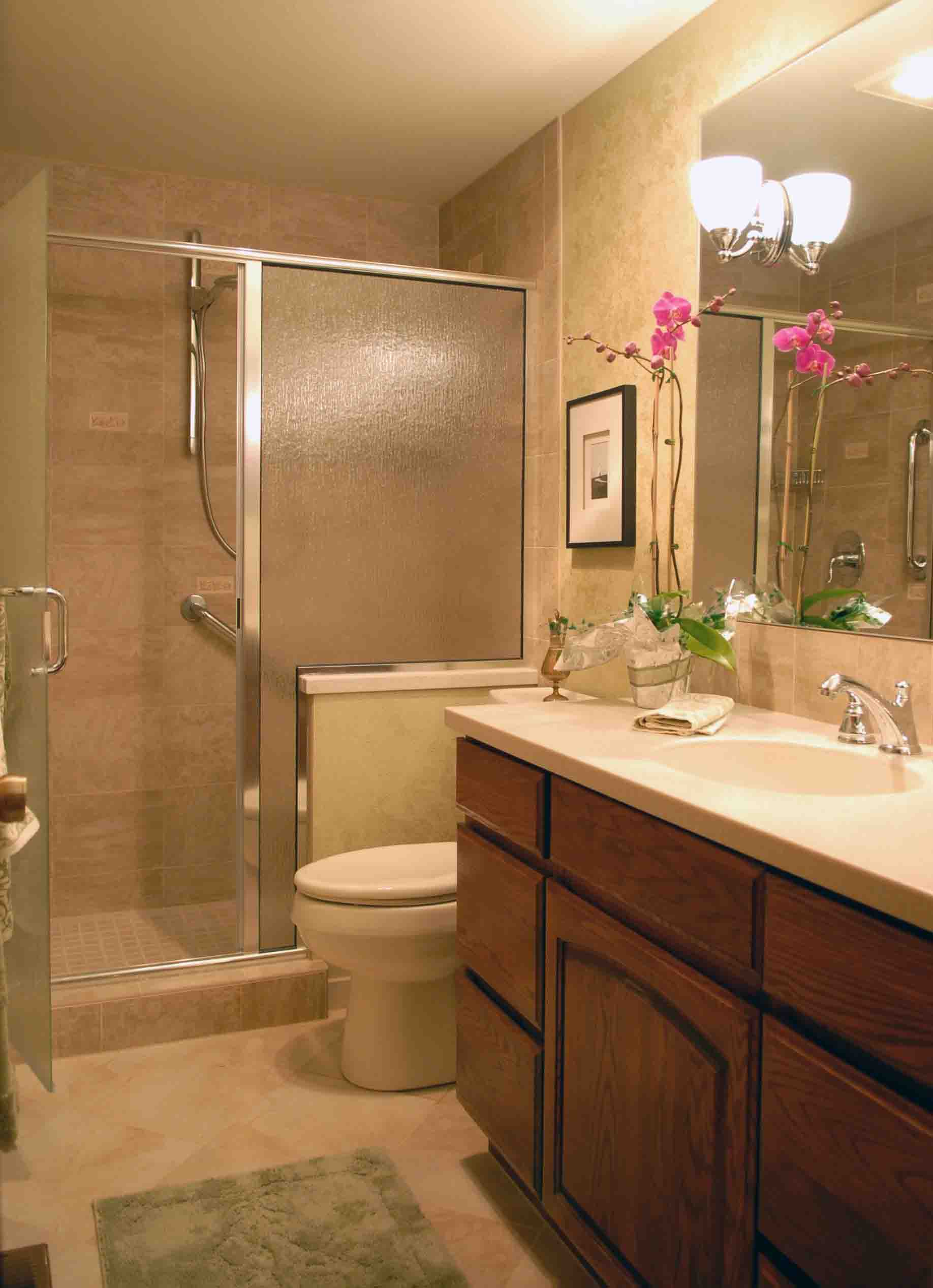 use oak vanity and closed shower space completing small bathroom remodel ideas with clear wall mirror - Ideas For Remodeling A Small Bathroom