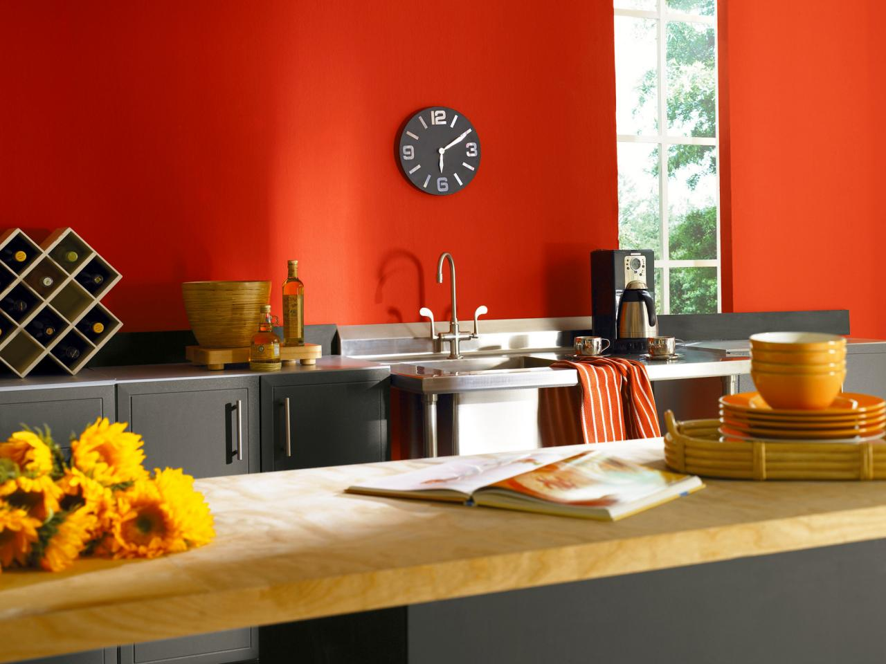 Use Orange Painted Wall for Unusual Kitchen Color Ideas in Contemporary Area with Grey Counter and Wine Rack