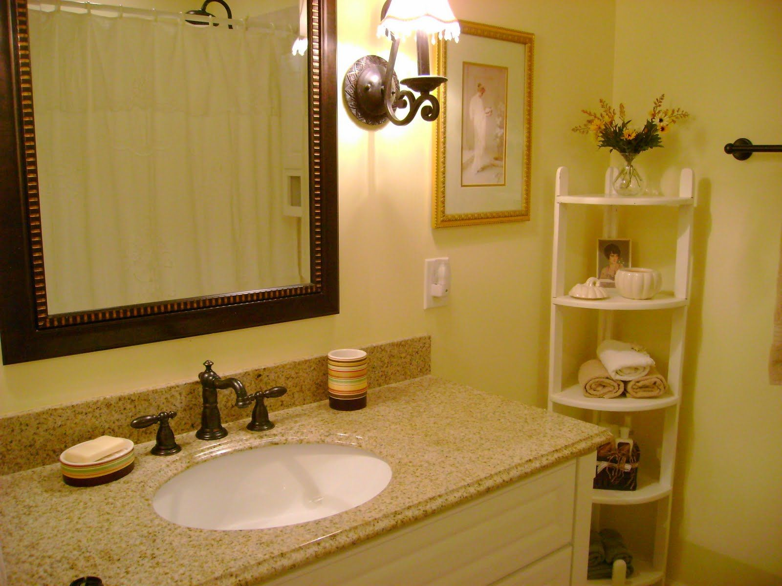 Use White Vanity and Granite Top for Traditional Room with Wooden Framed Bathroom Mirrors