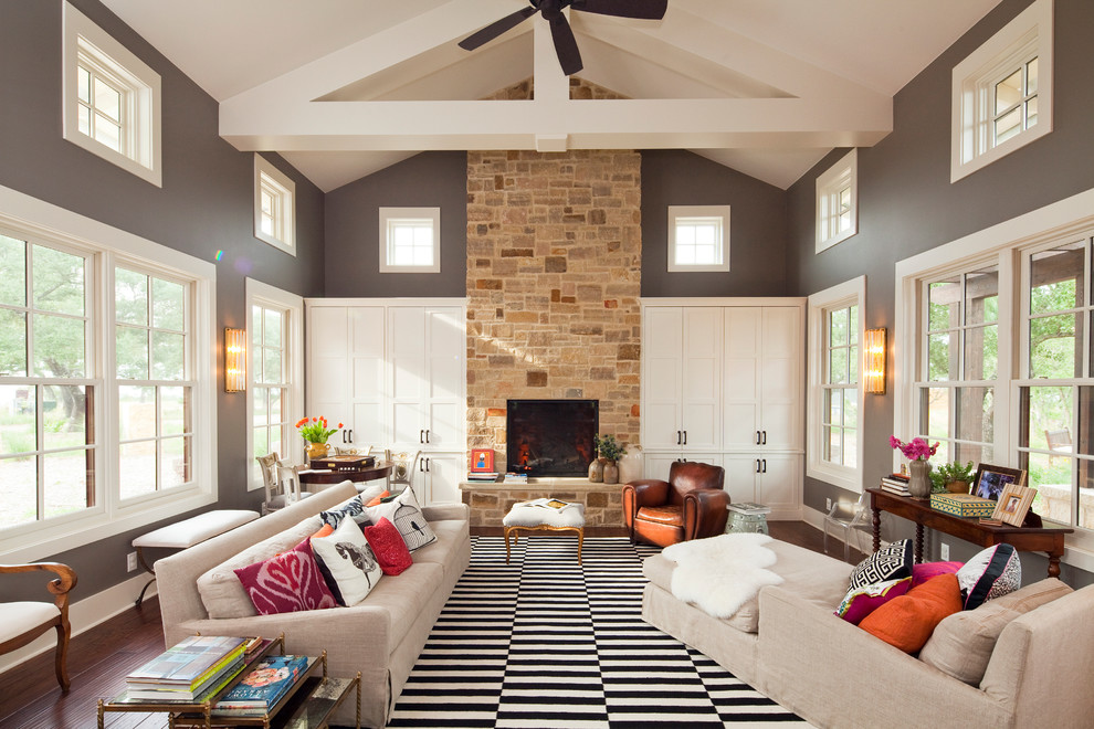 Use Wide Black and White Rug for Traditional Living Room with Cream Sofas and Colorful Cushions
