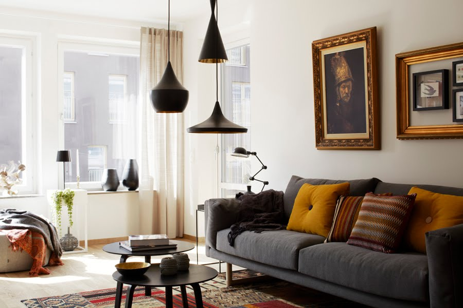 Ordinaire Vintage Wall Arts In Minimalist Family Room With Grey Sofa And Round Tables  Under Black Living