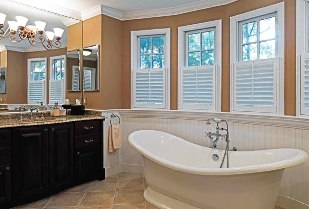 White Bathtub and Dark Oak Vanity Placed in Old Fashioned Bathroom with Cream Bathroom Paint Ideas