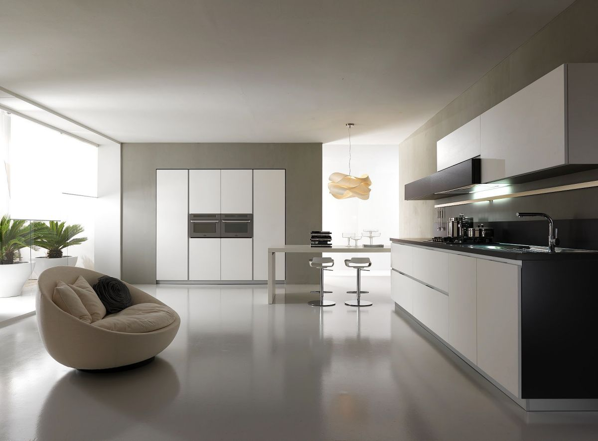 White Counter and Black Countertop Used in Modern Kitchen Design with Stylish White Stools