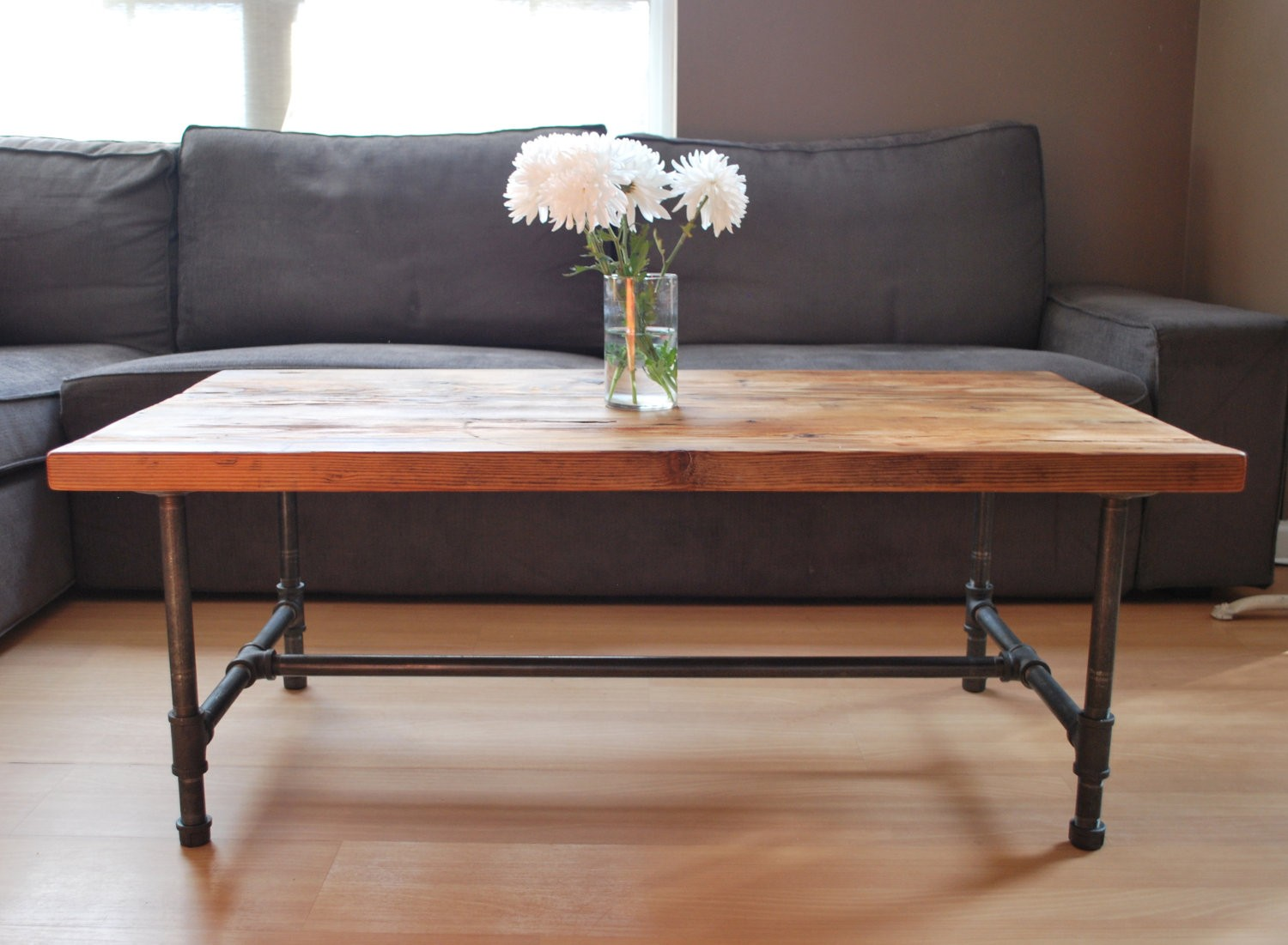 Tips to opt for large coffee table which look the best Wood and steel furniture