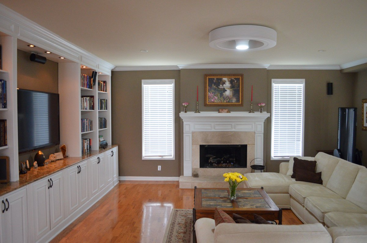 White Framed Fireplace Completing Traditional Living Room with Oak Coffee Table and Bladeless Ceiling Fan