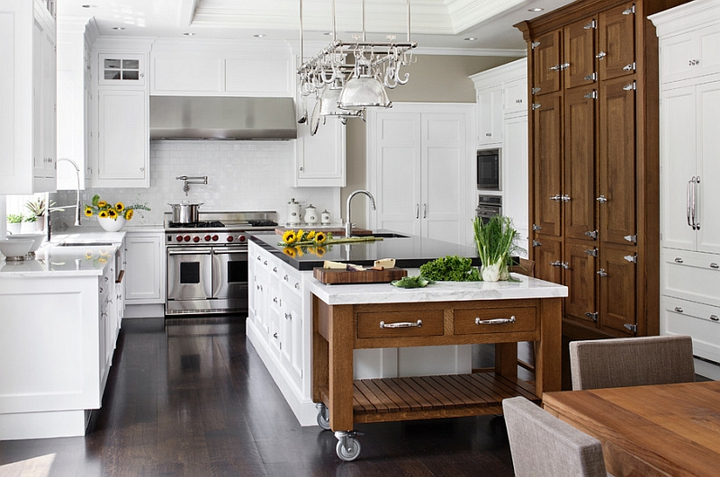 White Kitchen using White Cabinets and Wooden Rolling Kitchen Island on Laminate Teak Flooring