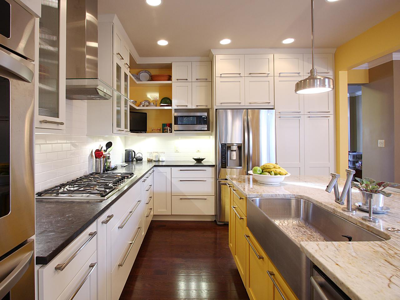 White Paint Kitchen Cabinets and Yellow Island on Laminate Oak Flooring in Cozy Kitchen
