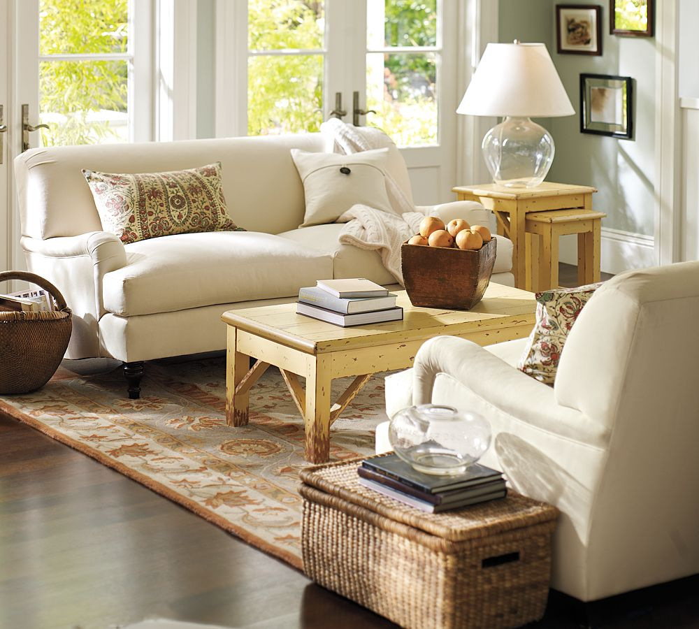 White Shaded Table Lamp on Oak Side Table Placed beside White Pottery Barn Sofa