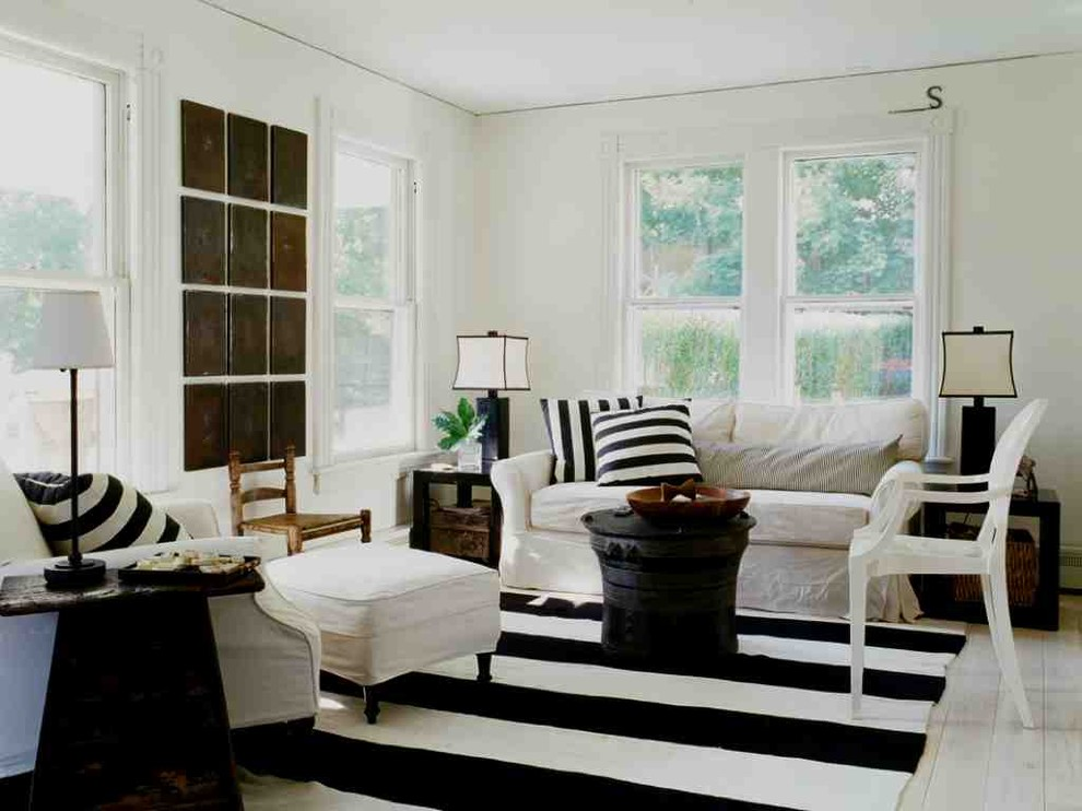 White Sofas and Chair facing Black Table on Interesting Black and White Rug for Family Room