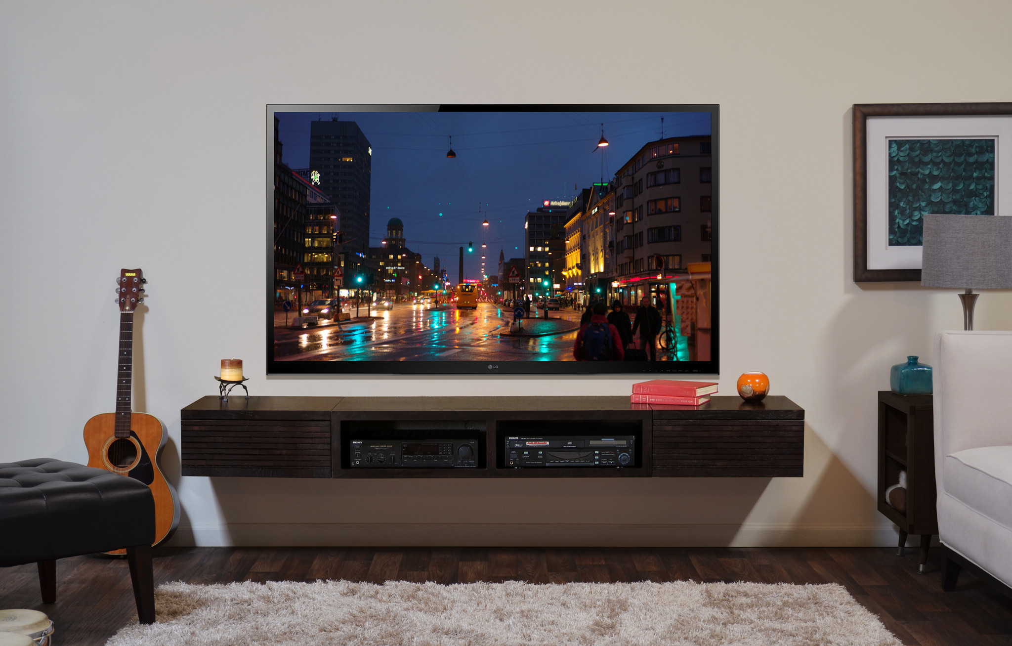 Wide Screen TV and Contemporary Wall Mount TV Stand Used inside Comfy Living Room with White Sofa