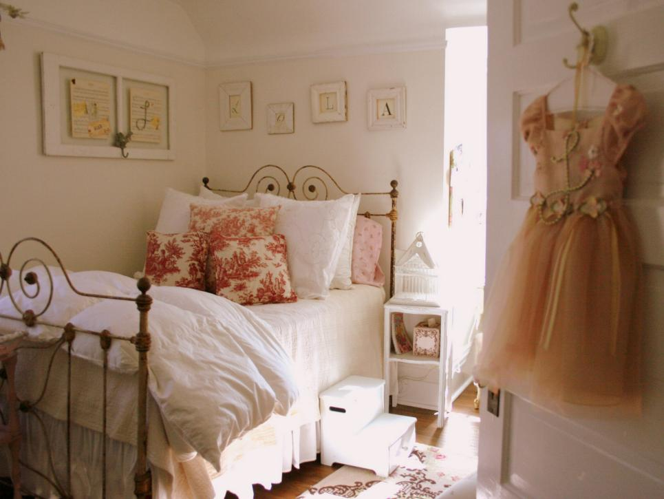 Wonderful Iron Bed with Neat Duvet and Flowery Pillow Cover