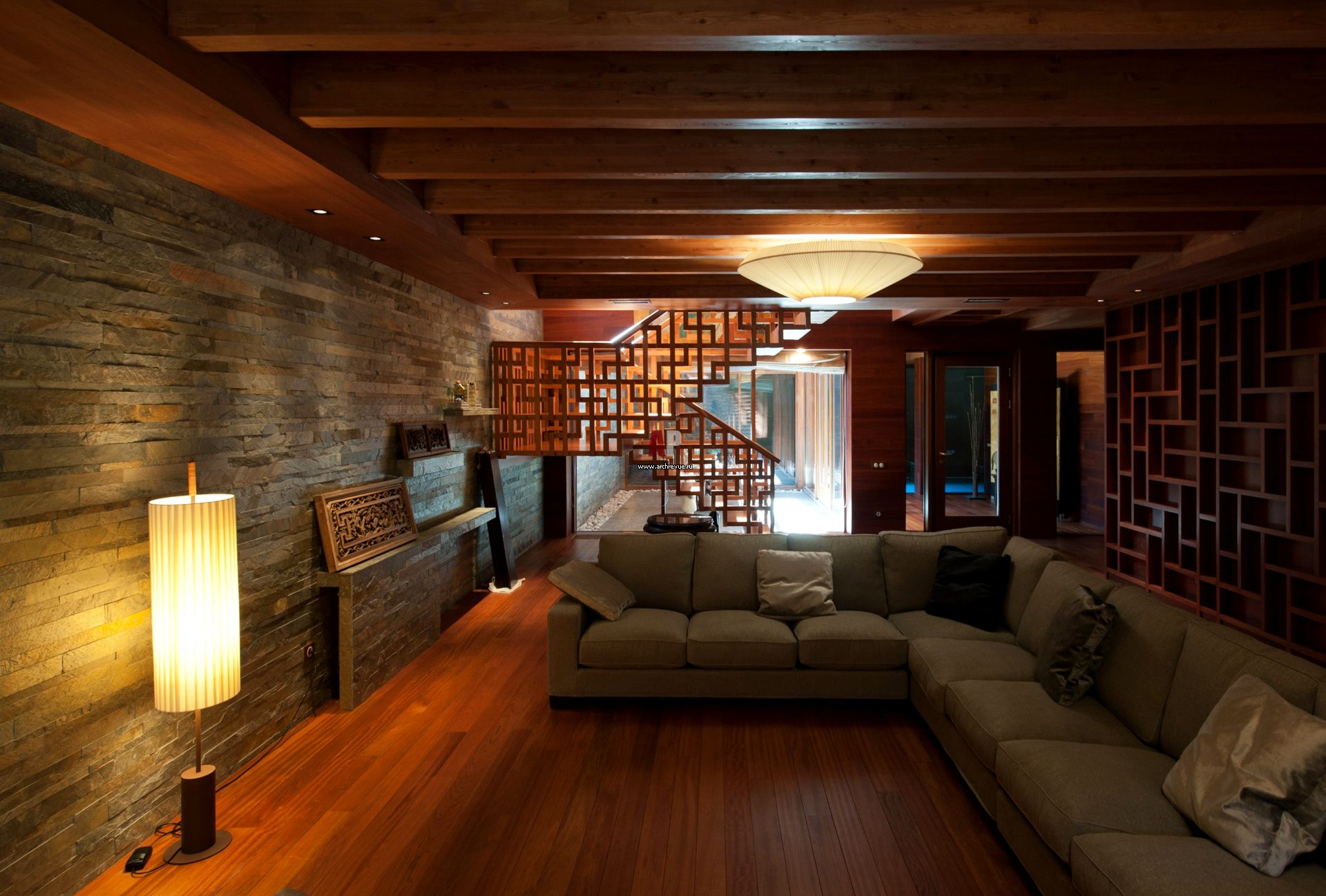 Wooden Beams Used For Natural Basement Ceiling Ideas Above Long Grey  Sectional Sofa And Hardwood Flooring