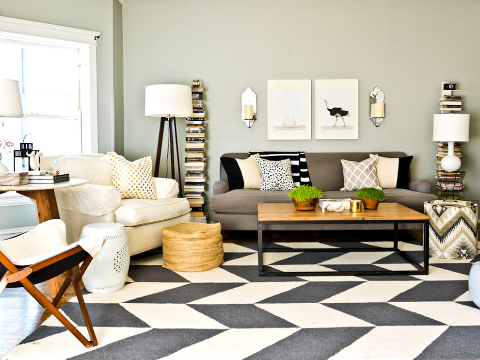 Wooden Coffee Table and Grey Sofa on Black and White Rug for Contemporary Sitting Space