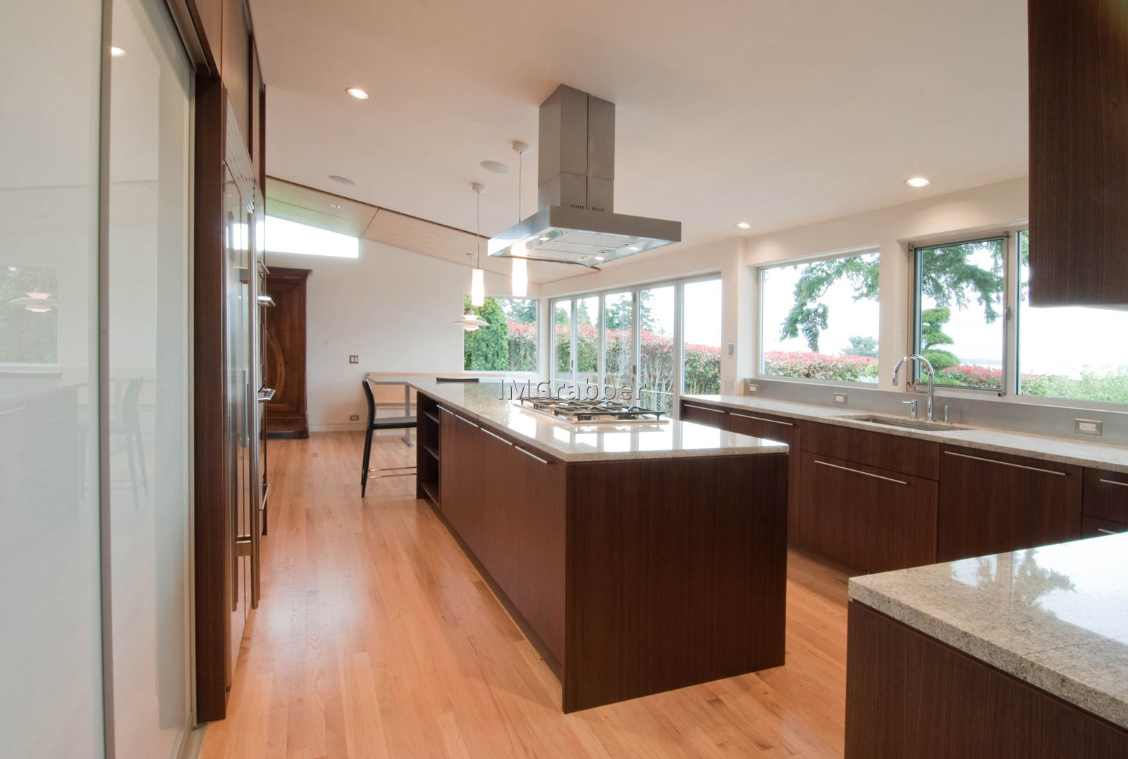Wooden Like Stainless Steel Kitchen Island Completing Wide Kitchen with Long Counter and Quartz Countertop